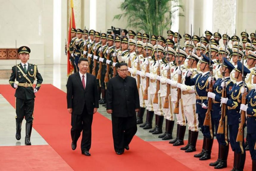 North Korean leader Kim Jong Un (third left) inspecting an honour guard while accompanied by Chinese President Xi Jinping (second left) during a welcoming ceremony at the Great Hall of the People in Beijing, on June 19, 2018.