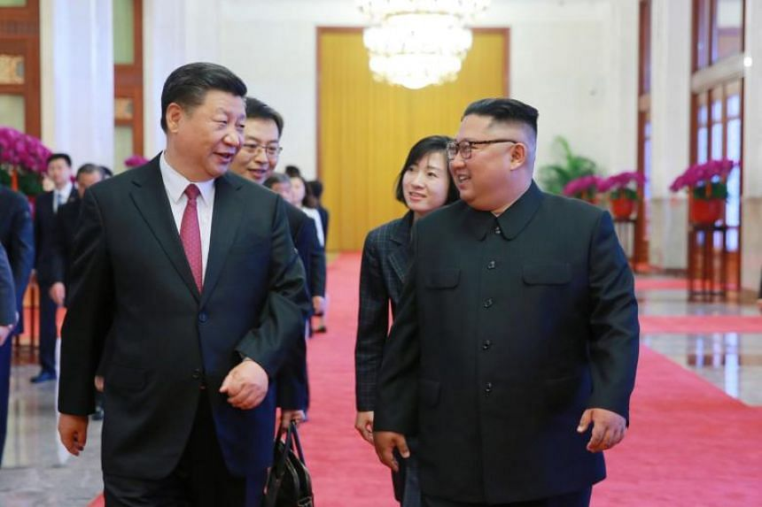 North Korean leader Kim Jong Un (right) walking with Chinese President Xi Jinping during their meeting in Beijing, China, on June 19, 2018.