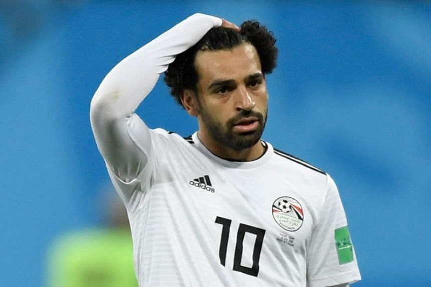 Egypt's forward Mohamed Salah reacts during the Russia 2018 World Cup Group A football match between Russia and Egypt at the Saint Petersburg Stadium in Saint Petersburg on June 19, 2018.