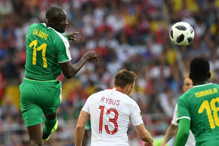 Senegal's midfielder Cheikh Ndoye (left) vies with Poland's midfielder Maciej Rybus during the Russia 2018 World Cup Group H football match between Poland and Senegal at the Spartak Stadium in Moscow on June 19, 2018.