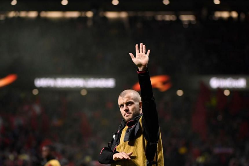 Arsenal's English midfielder Jack Wilshere waves at the end of the UEFA Europa League semi-final second leg football match between Club Atletico de Madrid and Arsenal FC at the Wanda Metropolitano stadium in Madrid on May 3, 2018.