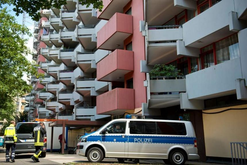 A police car is parked in front of an apartment building in Cologne's Chorweiler district on June 15, 2018, where a Tunisian suspected of trying to build a biological weapon was arrested three days before.