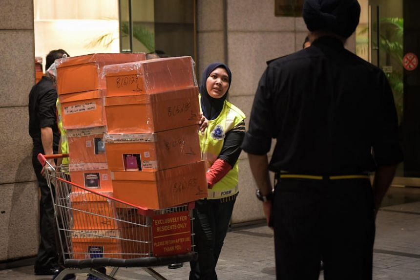 Malaysian police seizing boxes of designer handbags, other luxury items and cash from a condominium unit linked to Malaysia's former prime minister Najib Razak on May 17, 2018.
