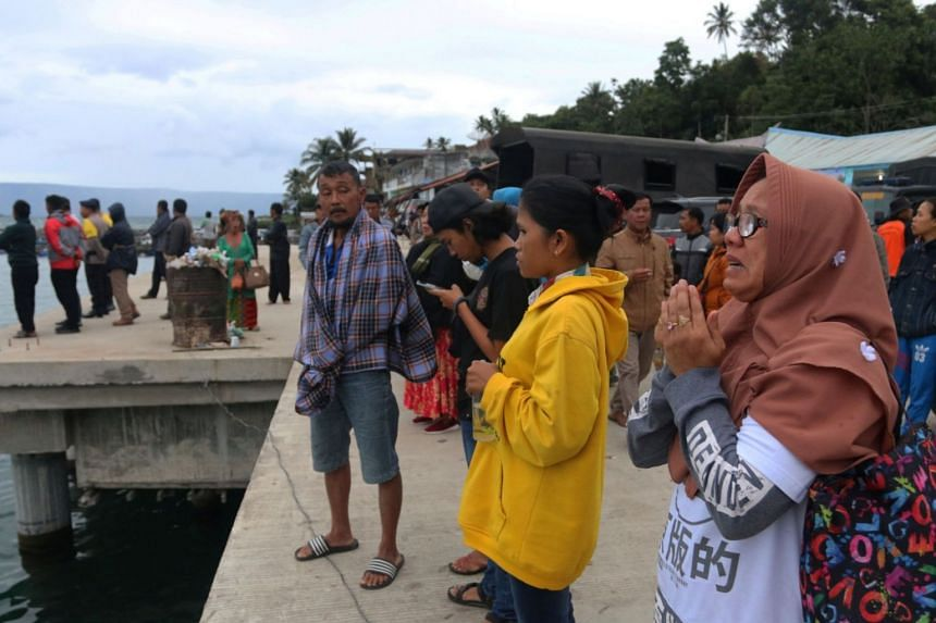 A woman prays for her son, a passenger on the KM Sinar Bangun ferry which sank in Lake Toba, in Simalungun, North Sumatra, Indonesia, on June 19, 2018