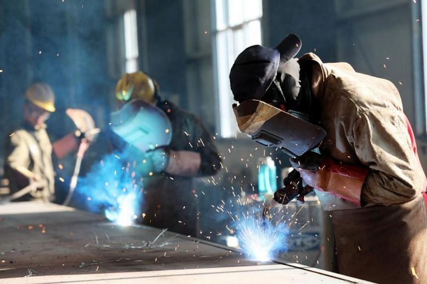 A worker cutting steel at a factory in Huaibei in China's eastern Anhui province, on May 3, 2018.