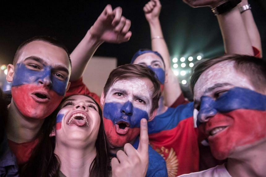 Russian fans celebrate after their team's victory over Egypt, at the Fan Zone in Rostov-on-Don, on June 19, 2018.