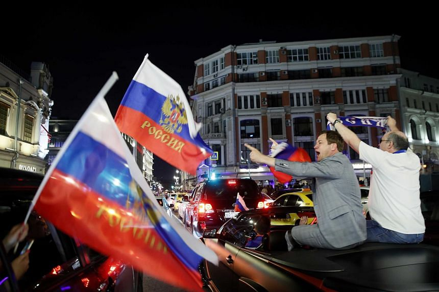 Fans celebrating on the streets of Moscow following Russia victory over Egypt, on June 19, 2018.
