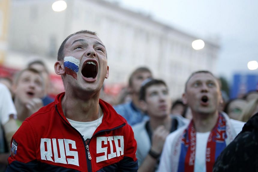 Fans reacting to the match between Russia and Egypt at the FIFA Fan Fest in Nizhny Novgorod, on June 19, 2018.