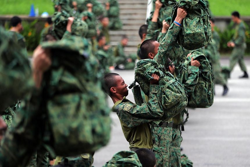 Soldiers from the 4th Battalion, Singapore Infantry Regiment, undergoing fitness training at Bukit Panjang Camp.