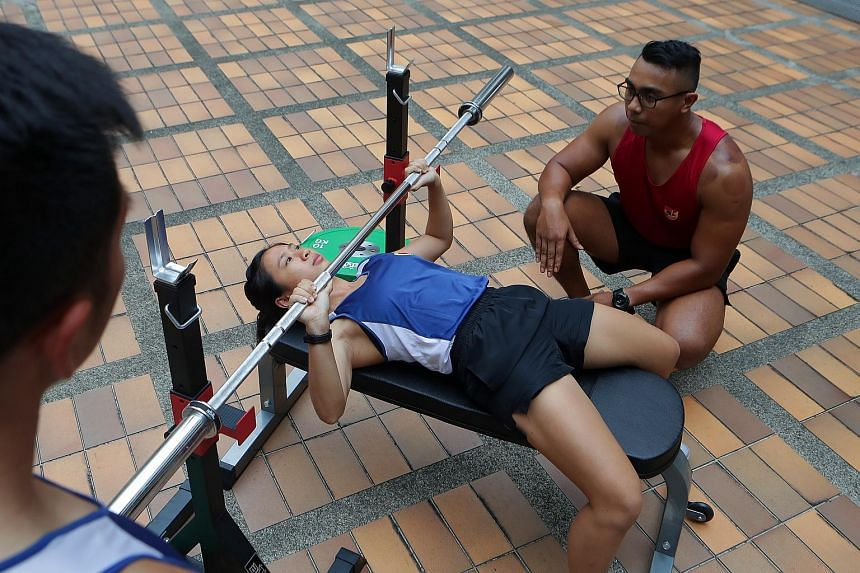 Second Sergeant Simone Goh undergoing training conducted by Master Sergeant Muhammad Faris Bin Azmi from the Advanced Combat Fitness Trainer, Centre of Excellence for Soldier Performance.