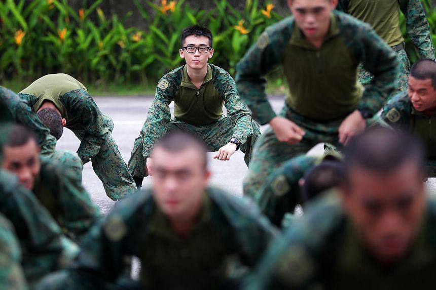 Third Sergeant Zheng Zuda (back row, facing camera) in the new faster-drying hybrid uniform.