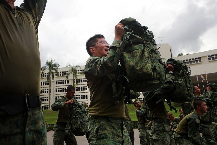 Chief of Defence Force Melvyn Ong (second left) training with soldiers while wearing the new hybrid uniform.