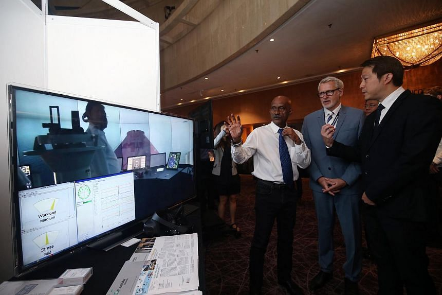 Senior Minister of State for Transport and Health Lam Pin Min (far right) viewing an exhibit at the third International Safety@Sea Conference on Wednesday (June 20).