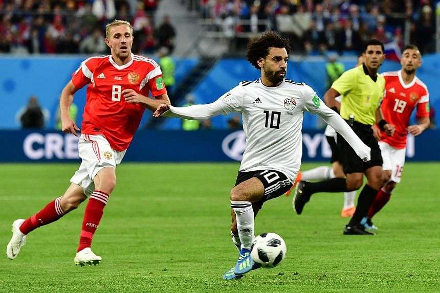 Egypt's forward Mohamed Salah (right) vies with Russia's midfielder Yuri Gazinskiy during the World Cup match at the Saint Petersburg Stadium, on June 19, 2018.