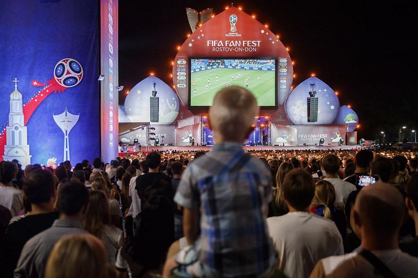Fans watch and react to the FIFA World Cup 2018 match between Russia and Egypt in the FIFA Fan Fest are in Rostov-on-Don, Russia, on June 19, 2018.