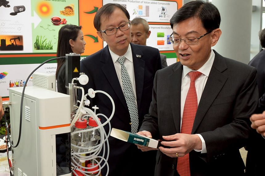 Finance Minister Heng Swee Keat (right) with Professor Ho Teck Hua, senior deputy president and provost of National University of Singapore, at the launch of WIL@NUS Corporate Laboratory.
