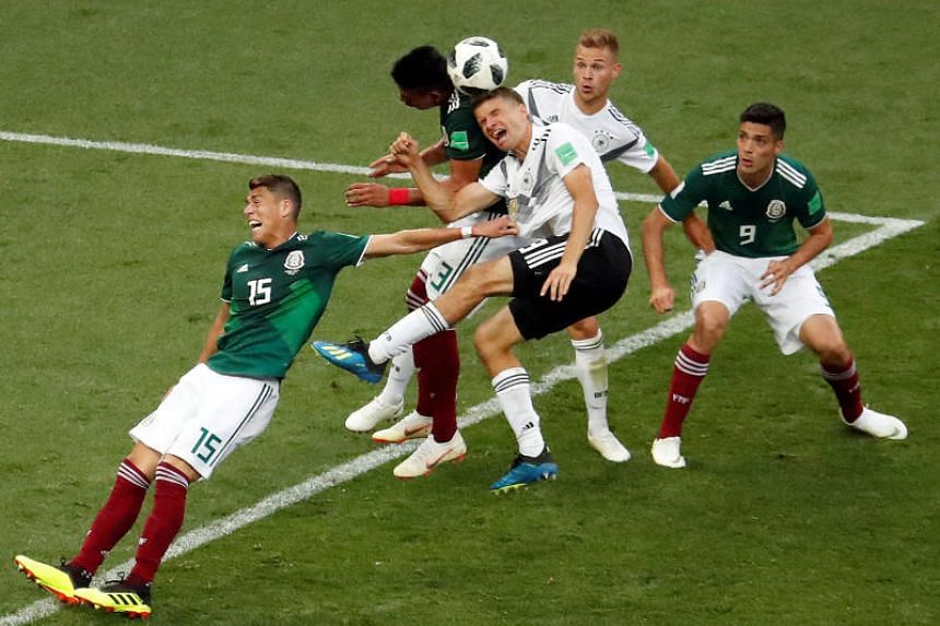Germany's Thomas Muller and Joshua Kimmich in action with Mexico's Hector Moreno, Raul Jimenez and Jesus Gallardo.