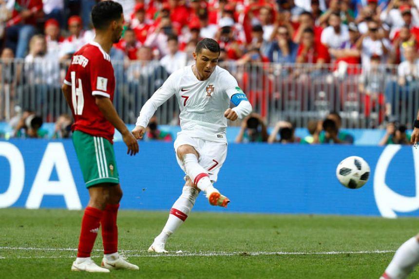 Portugal's Cristiano Ronaldo shoots at goal from a free kick.