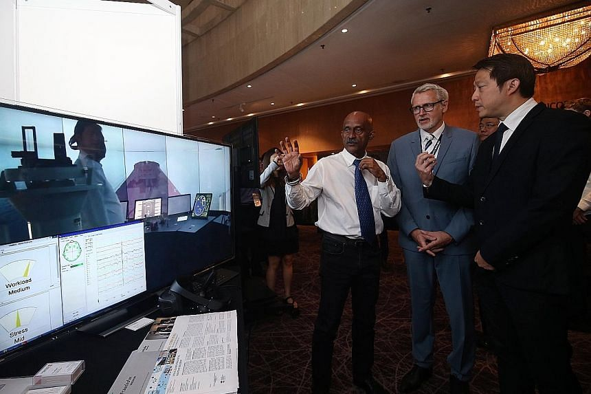 (From left) Captain Gopala Krishnan, research lead for the Centre of Excellence in Maritime Safety; Dr Wolfgang Müller-Wittig, executive director of Fraunhofer Singapore; and Senior Minister of State for Transport and Health, Dr Lam Pin Min, viewing