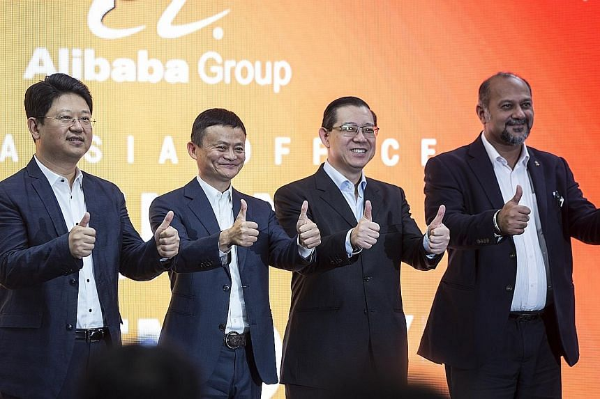 (From left) China's Ambassador to Malaysia Bai Tian, Alibaba founder Jack Ma, Malaysian Finance Minister Lim Guan Eng and Malaysian Communications and Multimedia Minister Gobind Singh Deo at the opening of Alibaba Group's office in Kuala Lumpur on Mo