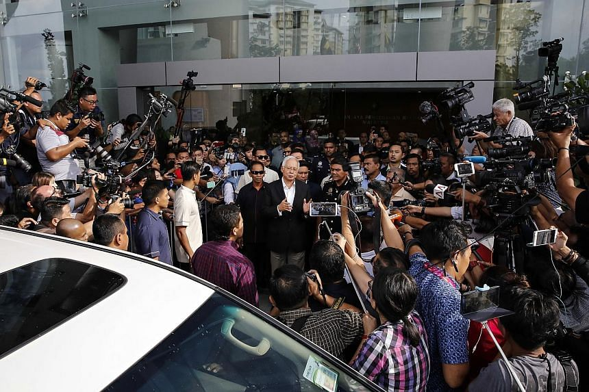 Former prime minister Najib Razak speaking to the media after being questioned by the Malaysian Anti-Corruption Commission at its headquarters in Putrajaya on May 24. The probe into flows of funds from 1MDB is being carried out by regulatory agencies