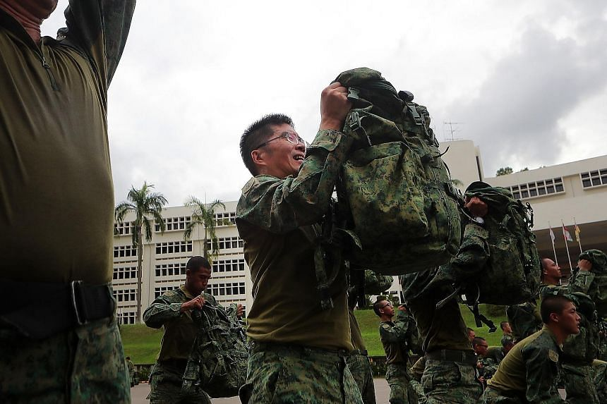 Major-General Melvyn Ong, the Chief of Defence Force, training with the soldiers while wearing the new hybrid uniform. The hybrid uniform will be worn during outfield exercises and combat physical training. For other routine activities such as parade