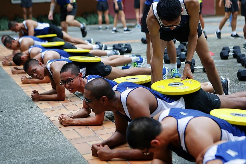 Soldiers from 4th Battalion, Singapore Infantry Regiment (4 SIR), in the customised Vocation Fitness Training programme at Bukit Panjang Camp.