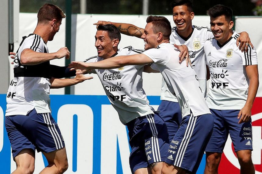 Angel di Maria (second from left) having a light moment with team-mates during an Argentina training session yesterday. La Albiceleste face Croatia today knowing they need to get two tasks right: supporting their talisman Lionel Messi and clinching v