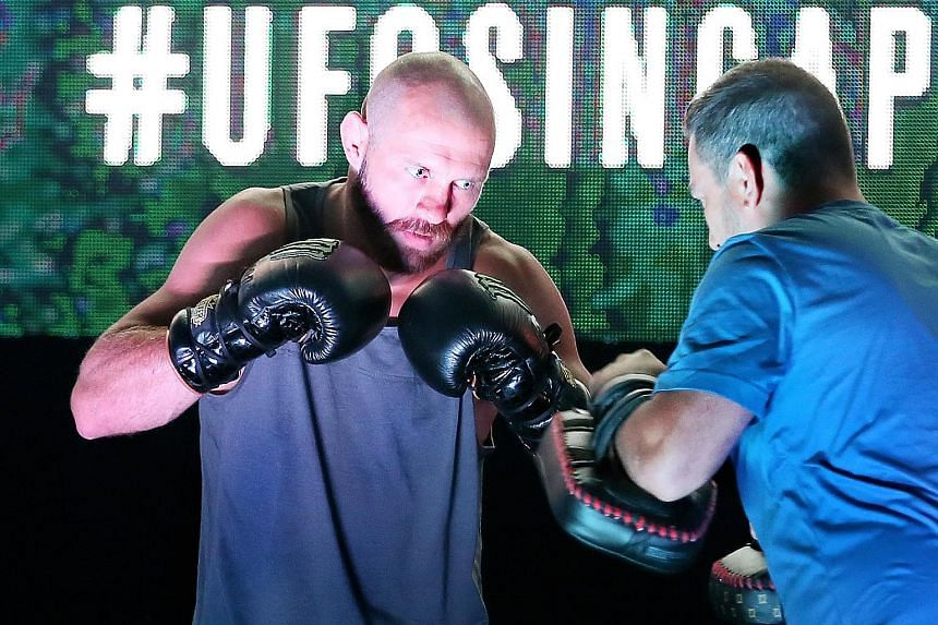 """Donald """"Cowboy"""" Cerrone in action at the open workouts at the OCBC Square yesterday, ahead of the UFC Fight Night Singapore event on Saturday."""