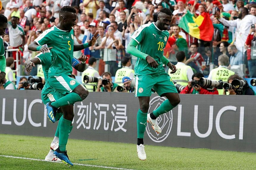 Senegal's M'Baye Niang (right) does a victory dance with Idrissa Gueye after scoring the winner in the 2-1 win over Poland on Tuesday. The Africans are level on three points at the top of Group H with Japan, who they will face next on Sunday.