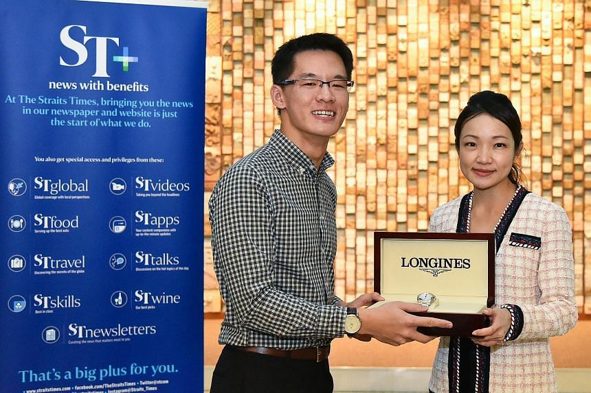 Timothy Toh receiving a Longines Conquest V.H.P. watch from Longines Singapore brand manager Jas Guo. He was one of 1,700 ST subscribers who entered a contest through the SPH Rewards app.