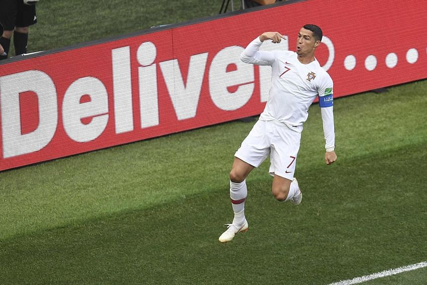 Portugal captain Cristiano Ronaldo celebrates after scoring with a header from a Joao Moutinho cross in the fourth minute to give his side a 1-0 win against Morocco yesterday, taking a second straight man of the match award. With 85 international goa