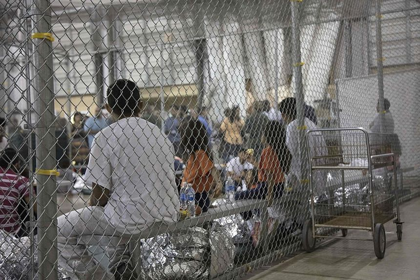 Immigrants at a central processing centre in McAllen, Texas. Sons and daughters are being ripped from their parents' arms and detention centres are filled with frightened children.
