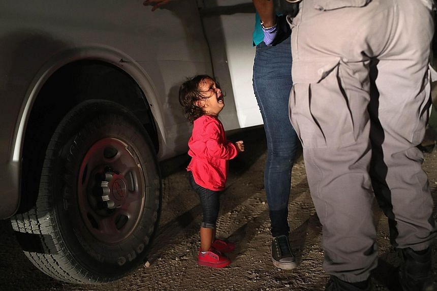 This picture of a two-year-old Honduran child crying as her mother is searched and detained near the US-Mexico border prompted California couple Charlotte and Dave Willner to start a fundraising page that would rapidly become the largest single fundr
