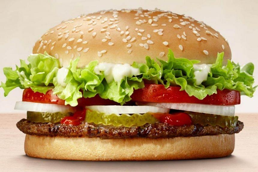 """In a social media post, Burger King's Russia team offered 3 million rubles (S$64,126) and a lifetime supply of Whopper burgers to """"women who get pregnant from world football stars."""""""