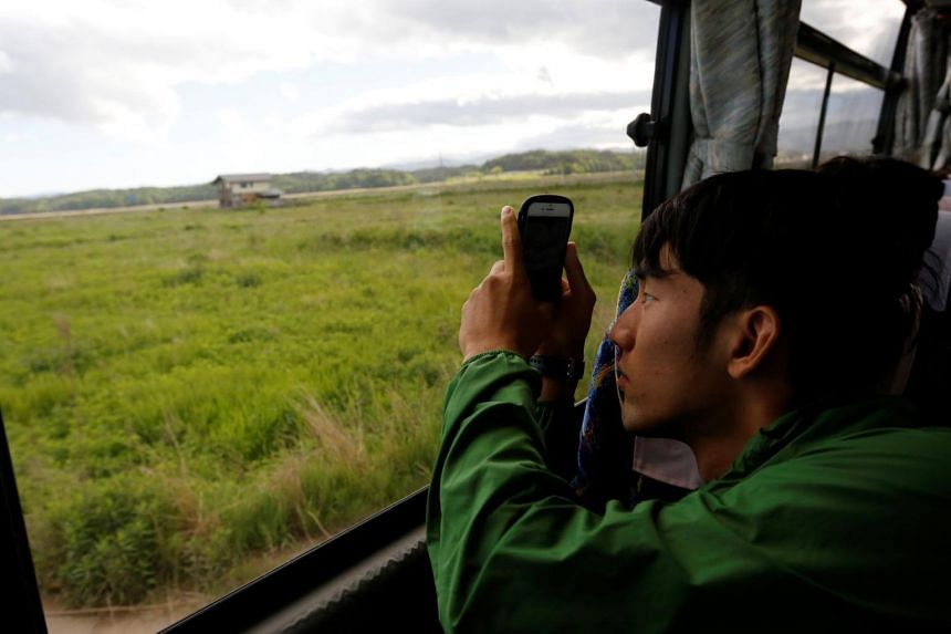 A university student taking photos of an area devastated by the 2011 earthquake and tsunami, near the Fukushima Daiichi nuclear power plant in Japan, on May 19, 2018.