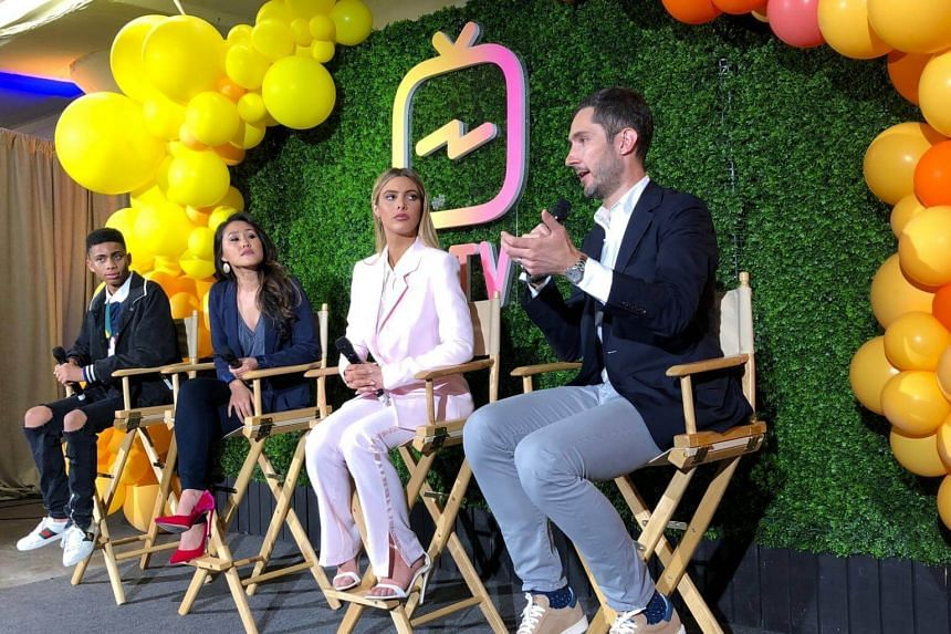 Instagram Chief Executive Kevin Systrom answers a question at a news conference, as (left to right) social media star Bryce Xavier, Instagram Product Manager Ashley Yuki and social media star Lele Pons look on, in San Francisco, California on June 20