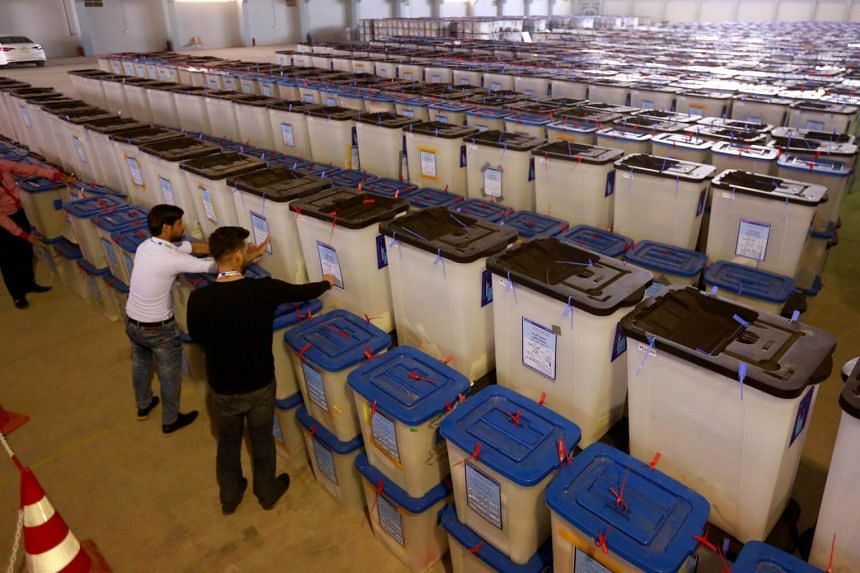 Employees of the Iraqi Independent High Electoral Commission inspect ballot boxes at a warehouse in Najaf, Iraq, on May 15, 2018.