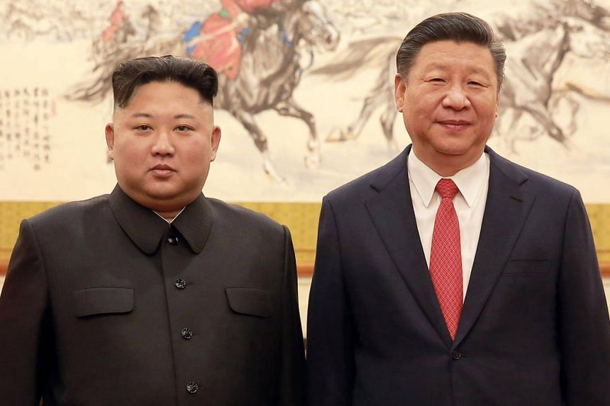 The meeting between Kim Jong Un (left) and Xi Jinping came on the former's second and last day of his latest visit to Beijing, where he briefed the Chinese president on his summit in Singapore.
