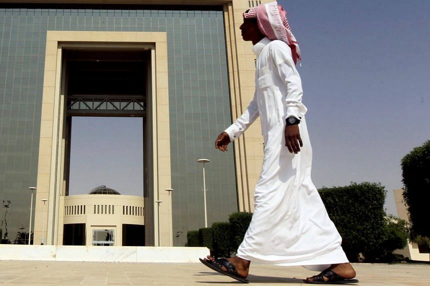 File photo showing a man walking in Riyadh, Saudi Arabia. While Saudi women are now allowed to drive, they still require permission from male relatives to enroll in classes, renew their passports and leave either the country or jail.