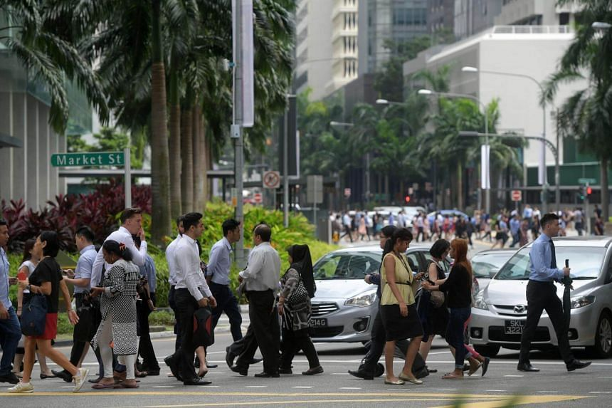 File photo showing a lunch crowd at Singapore's central business district, on June 29, 2017.