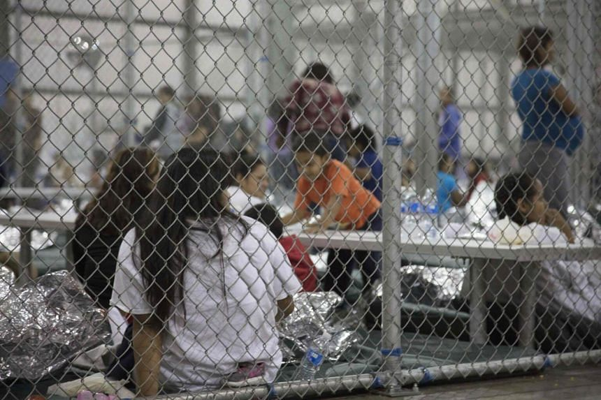 Illegal border crossers detained by US Border Patrol agents at the Central Processing Center in McAllen, Texas, on June 17, 2018.