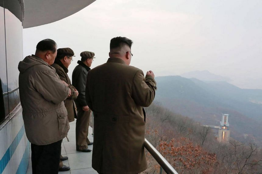 North Korean leader Kim Jong Un (right) inspecting the ground jet test of a high-thrust engine at the Sohae Satellite Launching Ground in North Korea, on March 19, 2017.