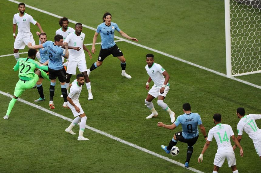 Luis Suarez scoring a goal for Uruguay during the match against Saudi Arabia.