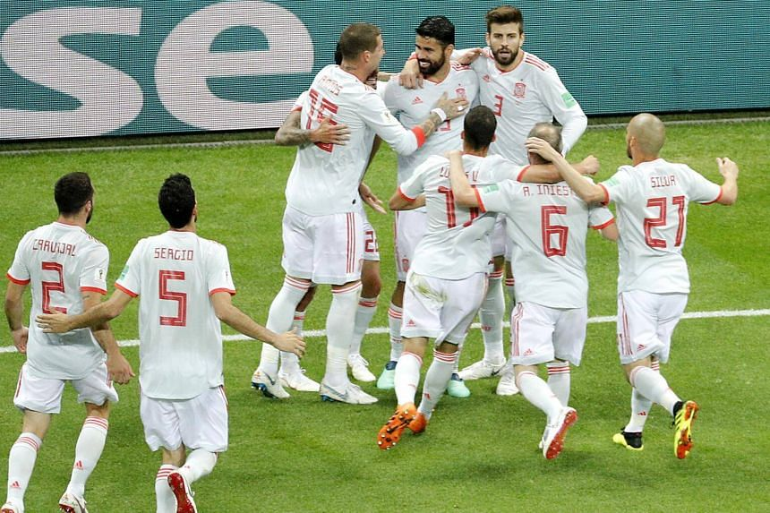 Spanish players celebrate after Diego Costa scores a goal against Iran during the World Cup match with Saudi Arabia.