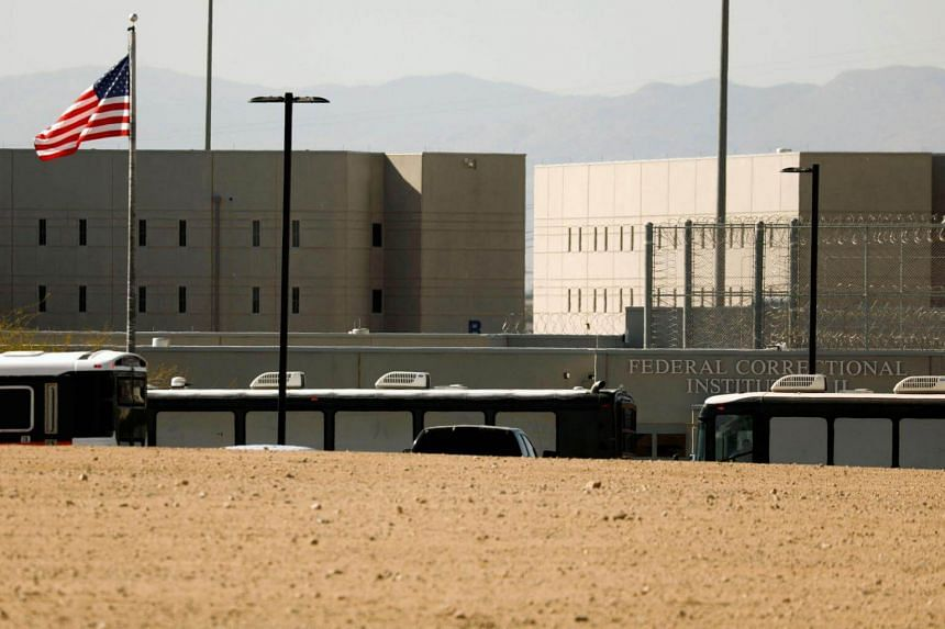 Immigration and Customs Enforcement detainees arrive at FCI Victorville federal prison in Victorville, California, on June 8, 2018.
