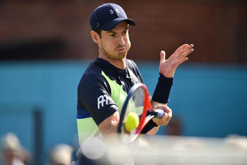 Britain's Andy Murray returns to Australia's Nick Kyrgios during their first round men's singles match at the ATP Queen's Club Championships tennis tournament in west London, on June 19, 2018.