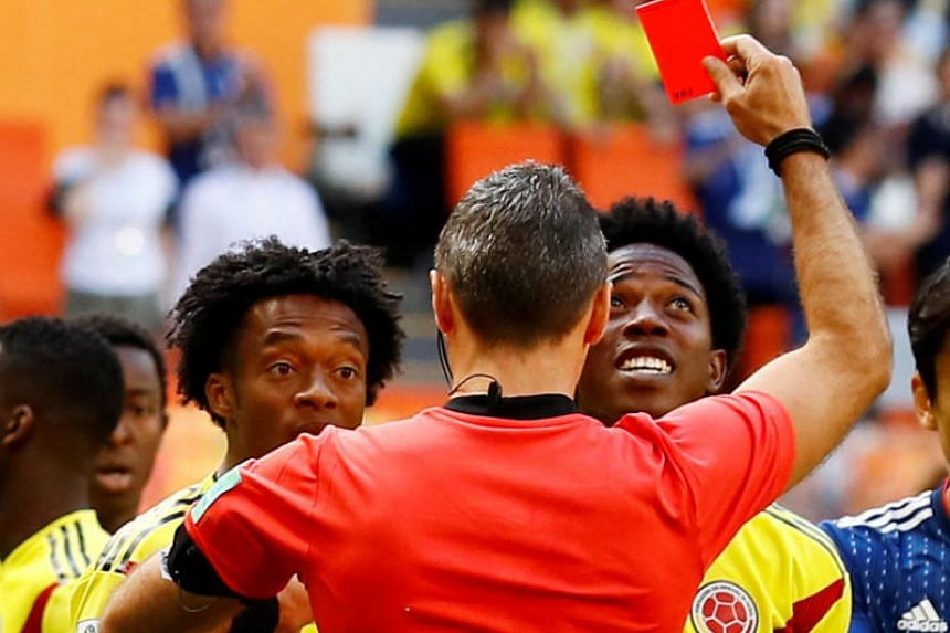 Colombia's Carlos Sanchez (right) is sent off by referee Damir Skomina during their match against Japan, on June 19, 2018.