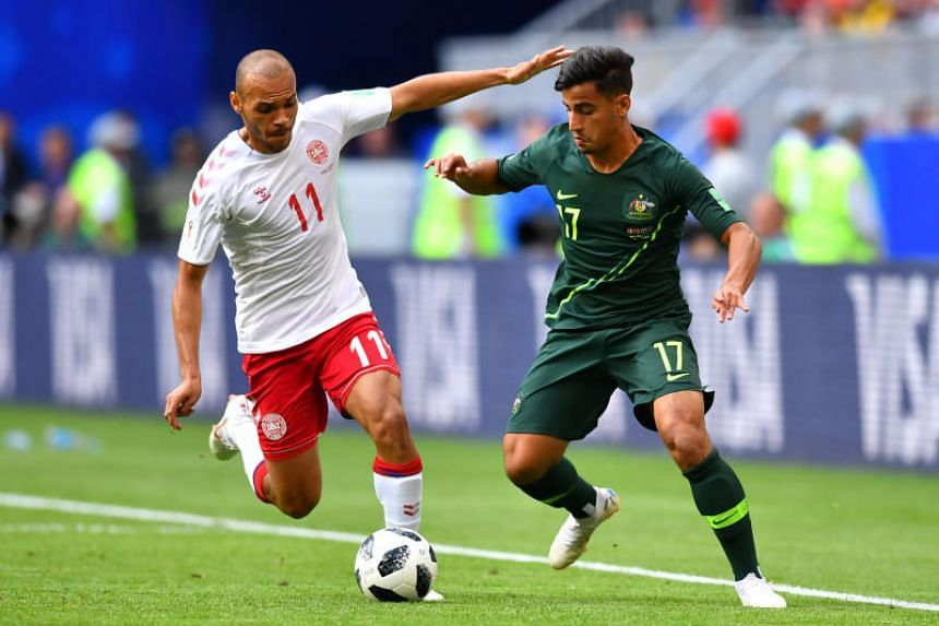 Denmark's Martin Braithwaite, who plays for English Championship side Middlesbrough, in action with Australia's Daniel Arzani.