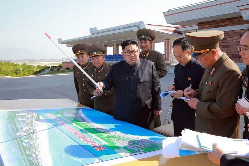 North Korean leader Kim Jong Un inspects the construction site of the Wonsan-Kalma coastal tourist area.